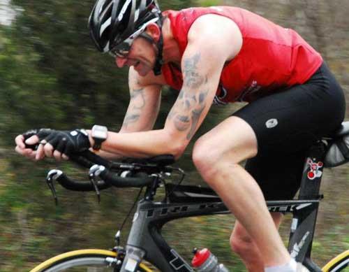 Tim VanDerKamp with Stay Wild Digital Marketing riding his bike in an Iron Man Challenge