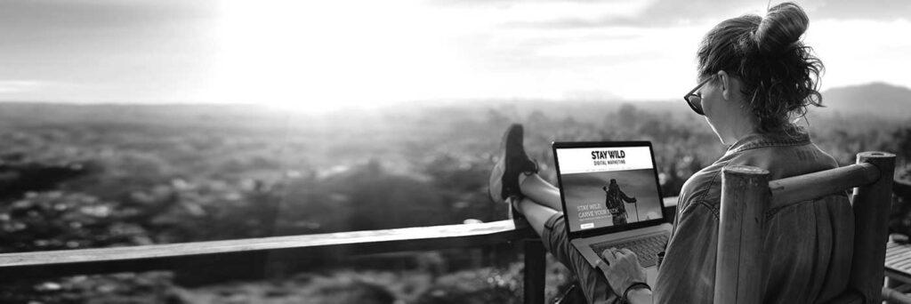 Woman on laptop sitting outside